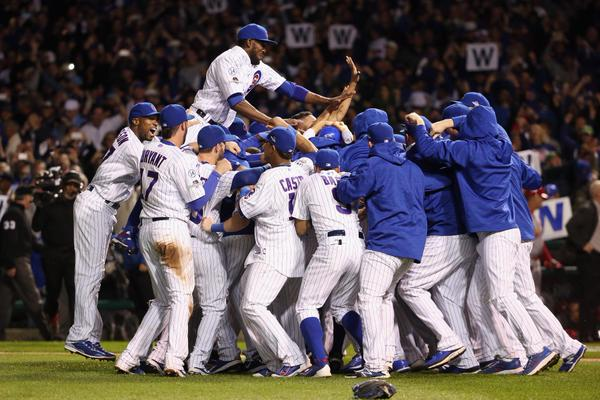 Cubs celebrate after defeating Cardinals at Wrigley Field, 10/13/15